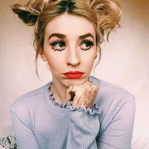 eyeliner abstract girl space buns blonde red lipstick